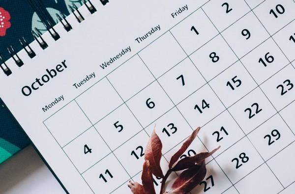 close up of a calendar open to October
